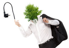 Green energy symbol. Man with green light bulb head and pin plug Stock Photography