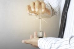 Green energy symbols ecology, light bulb in hand. Green energy symbols ecology, light bulb in a hand Stock Images