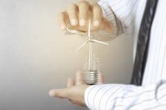 Green energy symbols ecology, light bulb in hand. Green energy symbols ecology, light bulb in a hand Stock Image