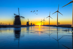 Green energy transition. Dutch traditional view of water management with canals and green energetic transition concept, The Hague, Netherlands Stock Photos