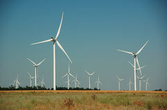 Green energy of wind turbines. Wind turbines, green energy and blue sky Royalty Free Stock Images