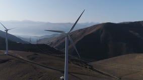 Green energy windmill turbine rotating at farm. Sustainability construction of windfarm converter kinetic windpower. Rotor wind-turbine smooth circling, infinite stock video footage
