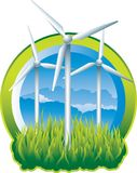 Green Energy Windmills. Three earth friendly windmills producing power Royalty Free Stock Photos