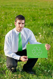 Green energy young businessman hold recycling sign Stock Images