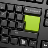 Green enter button in black keyboard Stock Image