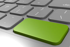 Green enter button in black keyboard Stock Photo