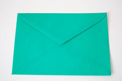Green envelope. Letter on white background stock photo