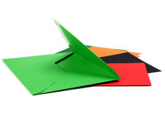 Green envelope with cards Royalty Free Stock Photos