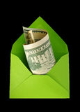Green envelope with dollars. Stock Image