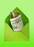 Green envelope with dollars. Royalty Free Stock Image