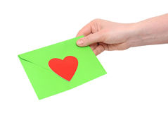 Green envelope and red heart Royalty Free Stock Images