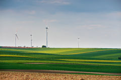 Green environment. Eco power. Wind turbines generating electricity. Spring sunny day. On green field with wind power generators in Austria royalty free stock image