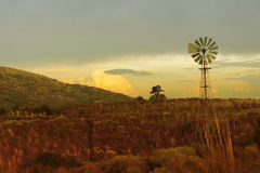 Green environment wind mill sunset sky landscape Stock Image