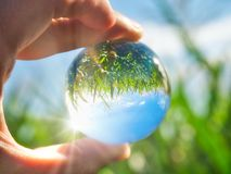 Green environment in your hands. Green natural environment hold in your hands as a glass ball planet - environment concept - clean and preserved environment royalty free stock photos