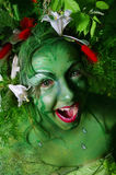 Green environmental face painting Stock Photo