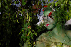 Green environmental face painting Royalty Free Stock Photography