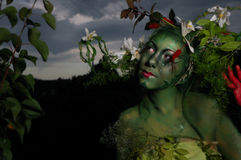Green environmental face painting Royalty Free Stock Images