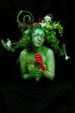 Green environmental face painting royalty free stock photography
