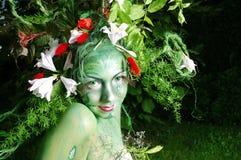 Green environmental face painting royalty free stock photo