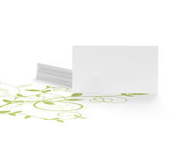 Green environmental message. Green floral design and blank  business card isolated on white, empty card is dedicated for an ecology message Royalty Free Stock Images