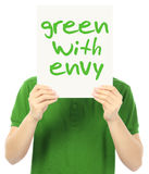 Green With Envy. A young man holding a poster indicating Green With Envy Stock Image