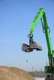 Green excavator Stock Photos