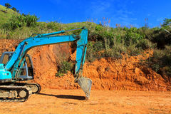 Green excavator working at construction site. With right copy space Stock Images