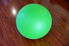 Green Exercise Ball. Green Rubber Workout Training Ball on floor Stock Photography