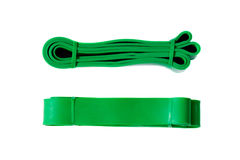 Green exercise band for fitness from two perspectives Stock Photos