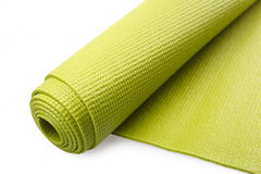 Green exercise mat. Isolated on white background royalty free stock photos