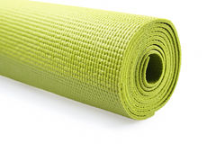 Green exercise mat. Isolated on white background Stock Photo