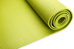 Green exercise mat. Isolated on white background Royalty Free Stock Images