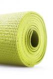 Green exercise mat. Isolated on white background stock photo