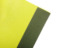 Green exercise mat. Isolated on white background stock images
