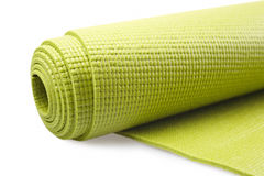 Green exercise mat. Isolated on white background Stock Image