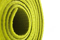 Green exercise mat. Isolated on white background Royalty Free Stock Photo