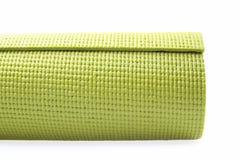 Green exercise mat. Isolated on white background royalty free stock image