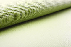 Green exercise mat. Сlose up of green yoga mat Royalty Free Stock Images