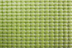 Green exercise mat. Сlose up of green yoga mat Stock Images