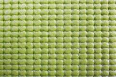 Green exercise mat. Сlose up of green yoga mat. macro shot stock images