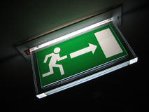 Green Exit Sign On Ceiling Stock Photography