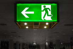 Green Exit Signal. At the airport Royalty Free Stock Images