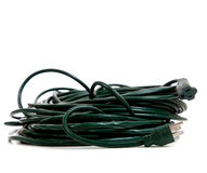 Green extension cord on a white background. A rolled up green extension cord on a white background with copy space royalty free stock photo