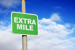 Green extra mile sign stock photo