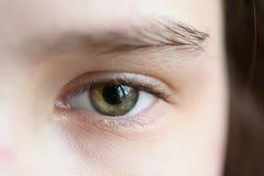 Green eye of the girl close up macro Stock Photo