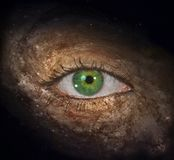 Galactic Eye. Green Eye in Universe. Human elements were created with 3D software and are not from any actual human likenesses Stock Photo