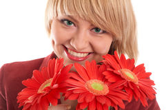 Green-eyed girl with flowers Royalty Free Stock Image