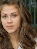 Green eyed girlie. Green eyed teenager girl, with middle brown natural hair royalty free stock photos