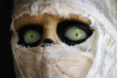 Green-eyed mummy. Mummy wrapped in gauze Royalty Free Stock Images
