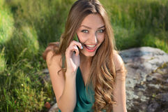 Green eyed sensual excited lady in green dress royalty free stock images